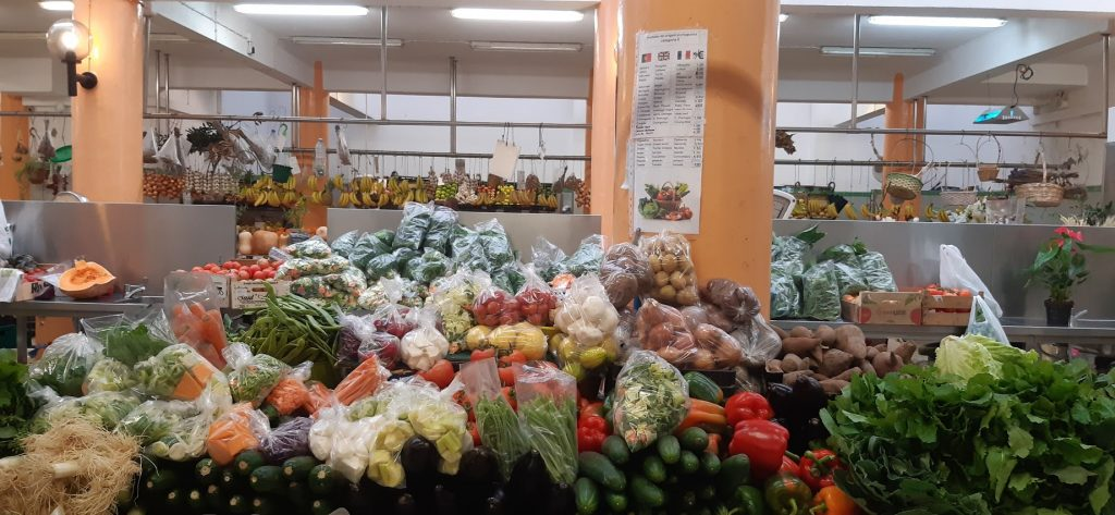 Winter vegetable stall overview, market hall in Ericeira