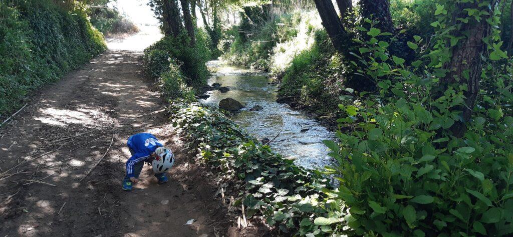 Boy playing on the path along Ribeira do Cuco in Santo Isidoro